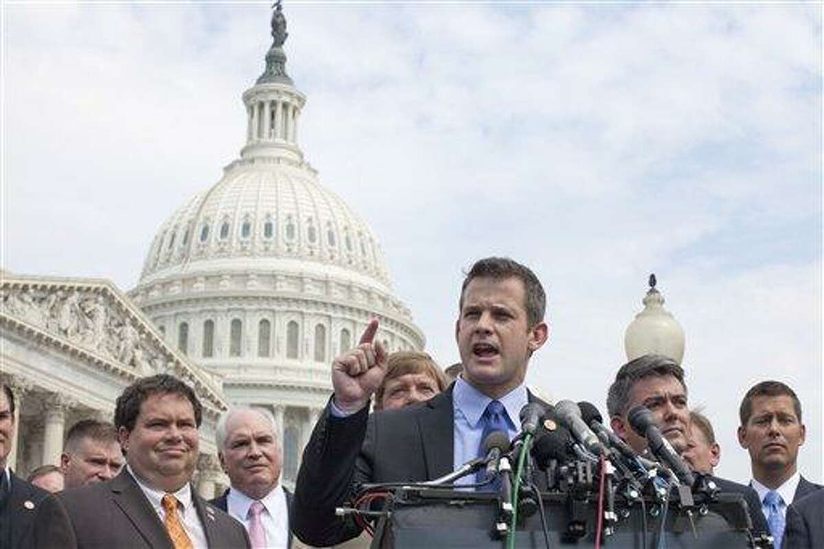 Rep. Adam Kinzinger, R-Ill., accompanied by fellow freshmen House members, gestures during a news conference on Capitol Hill in Washington on Thursday, July 28, 2011, to announce they'll vote yes later Thursday on the GOP plan to raise the debt limit. Rep. Blake Farenthold, R-Texas is second from left, Rep. Cory Gardner, R-Colo. is second from right, Rep. Sean Duffy, R-Wis. is at right. (AP Photo/Harry Hamburg)