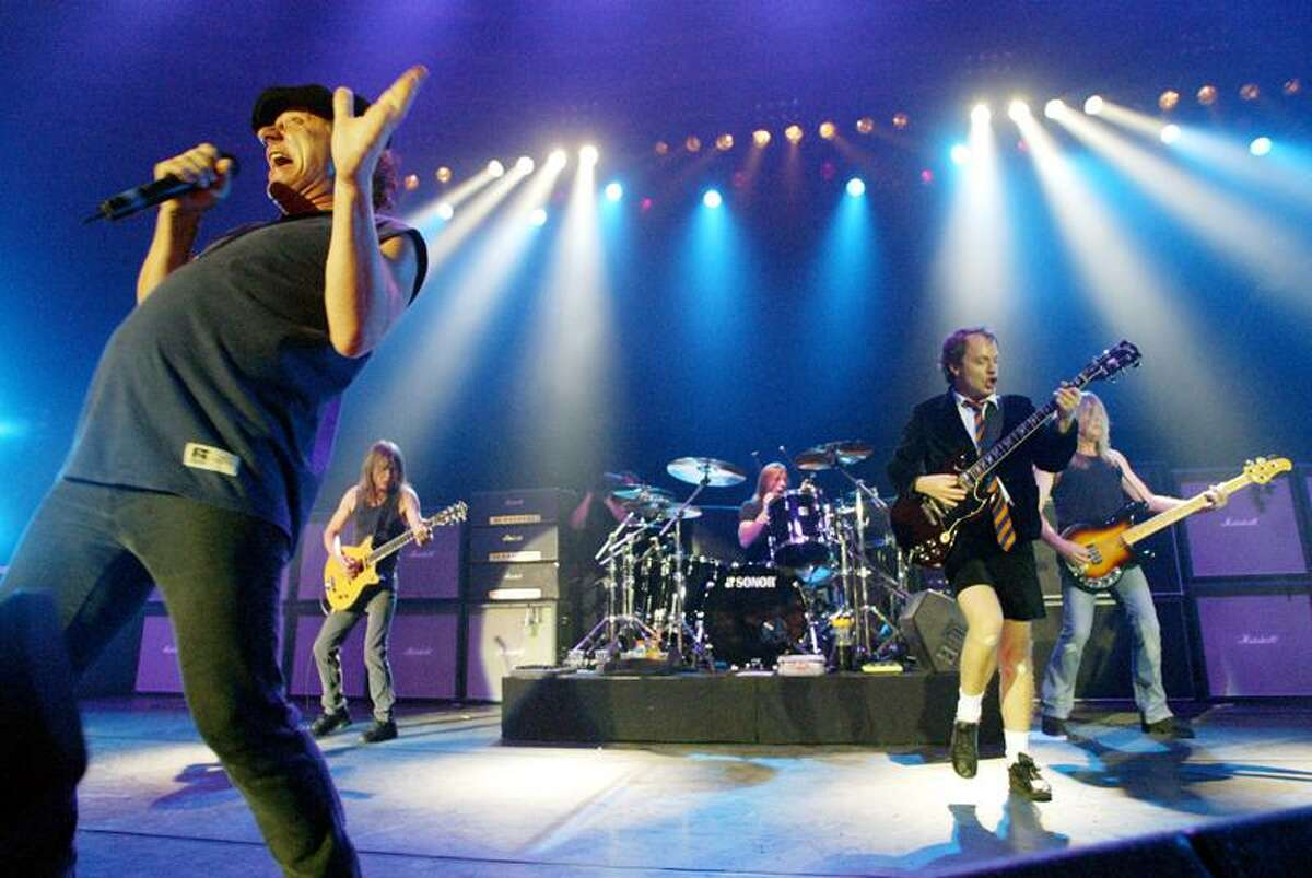 British rock band AC/DC with singer Brian Johnson, left, and guitar player Angus Young, 2nd right, perform on stage during a concert in Munich, southern Germany, on Tuesday, June 17, 2003. (AP Photo/Jan Pitman)