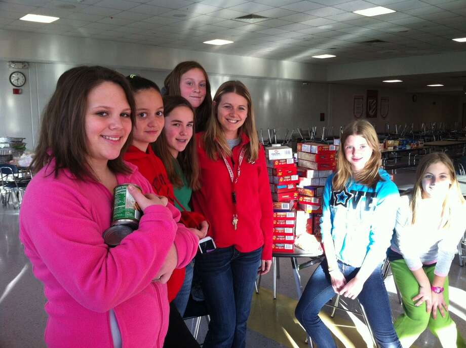 Photo provided by Candy Perez  Northwestern Regional Middle School students show the donated food they collected Tuesday for Thanksgiving baskets.