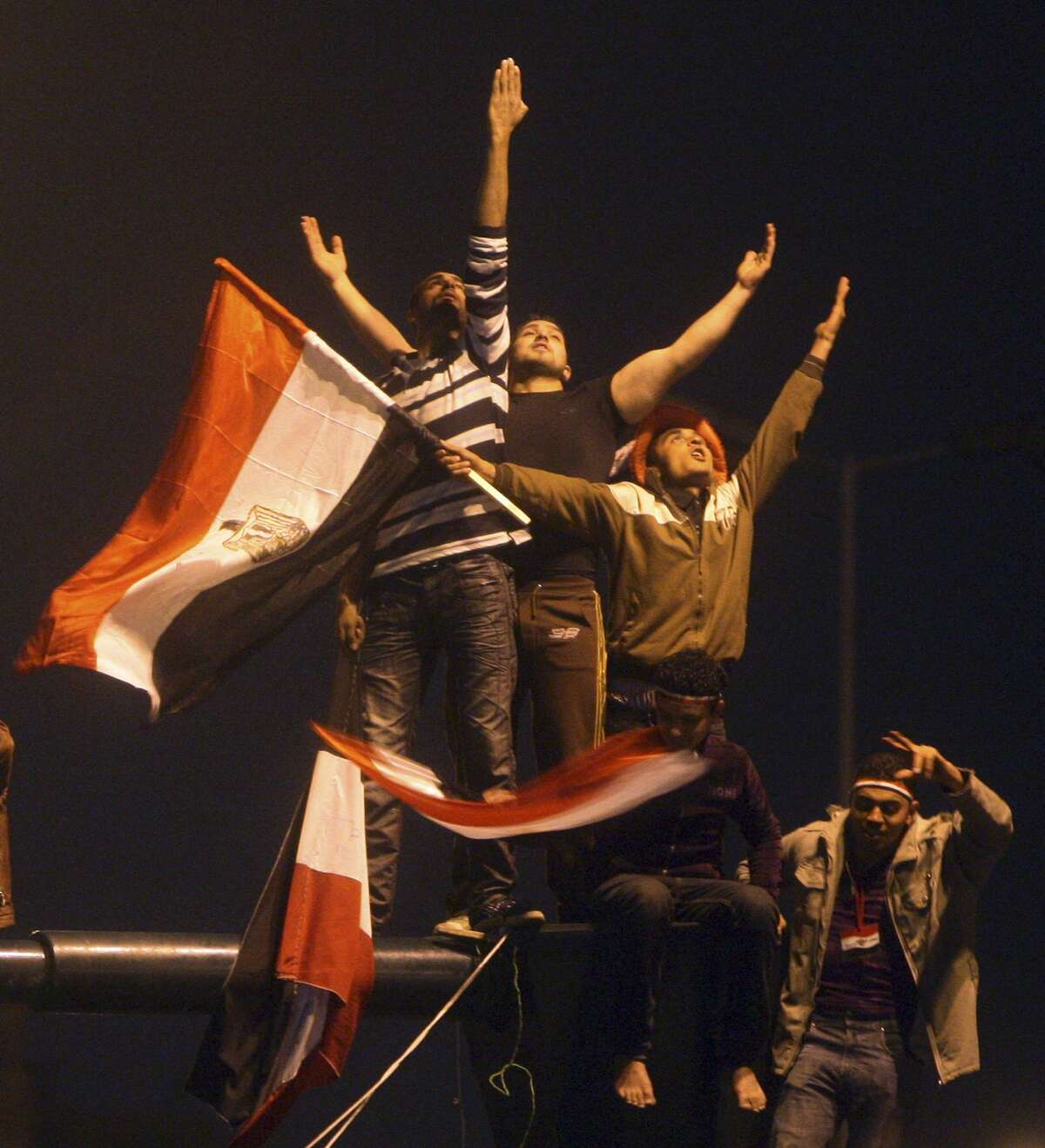 Egyptians celebrate in Tahrir Square after President Hosni Mubarak resigned and handed power to the military in Cairo, Egypt, Friday, Feb. 11, 2011. Egypt exploded with joy, tears, and relief after pro-democracy protesters brought down President Hosni Mubarak with a momentous march on his palaces and state TV. Mubarak, who until the end seemed unable to grasp the depth of resentment over his three decades of authoritarian rule, finally resigned Friday and handed power to the military.(AP Photo/Ahmed Ali)