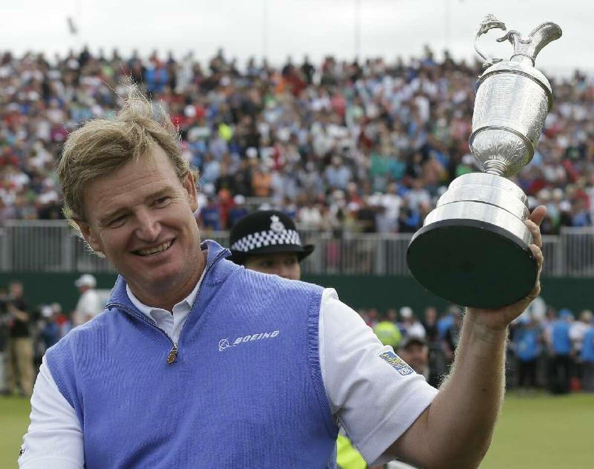 ASSOCIATED PRESS Ernie Els of South Africa holds up the Claret Jug trophy after winning the British Open Golf Championship at Royal Lytham & St Annes golf club, Lytham St Annes, England, on Sunday.