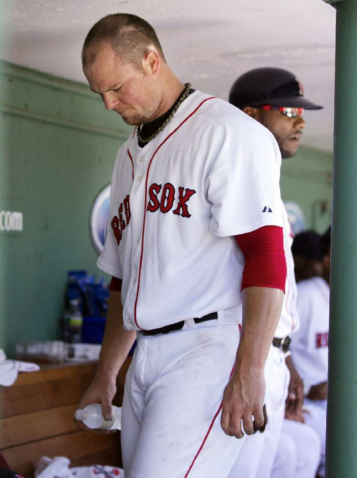 ASSOCIATED PRESS Boston Red Sox pitcher Jon Lester looks down in the dugout after being pulled in the fifth inning of Sunday's game against the Toronto Blue Jays at Fenway Park. The Blue Jays won 15-7.