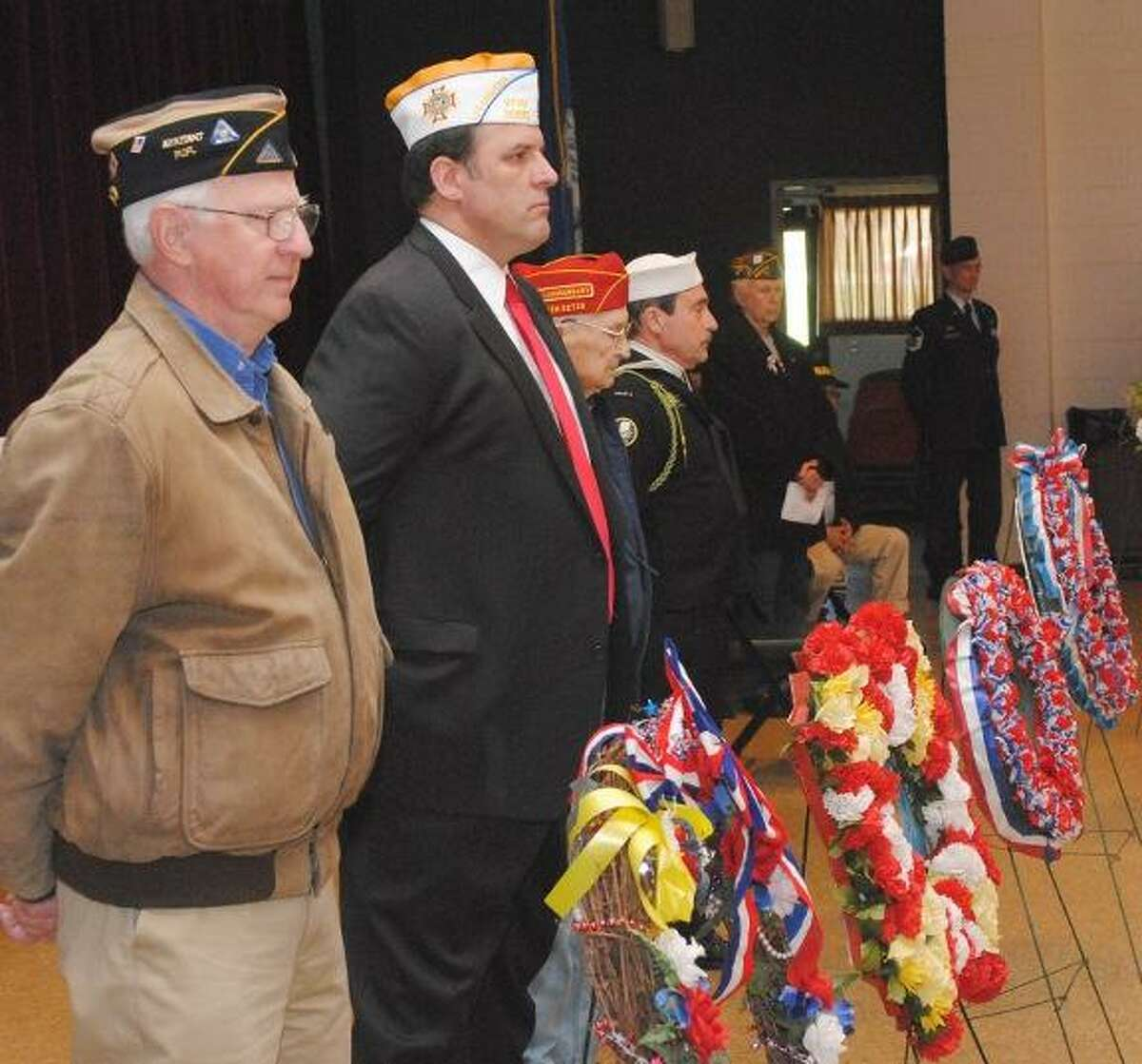 MIKE AGOGLIATI/ Register Citizen Joe Pathe, left and Bob Hunter, right were two of more than 30 veterans that participated in a Vietnam remembrance ceremony held at Coe Memorial Park Friday.