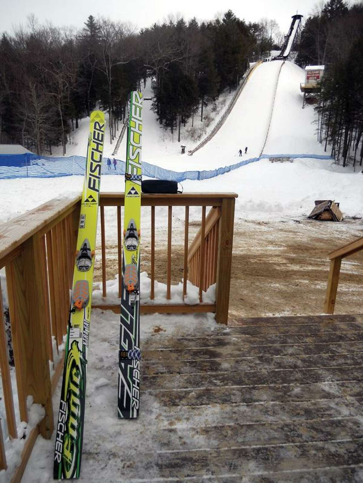 CHRIS RUELI/ Register CitizenA pair of Fischer jumping skis sit on the deck in front of the 300-foot ski jump.