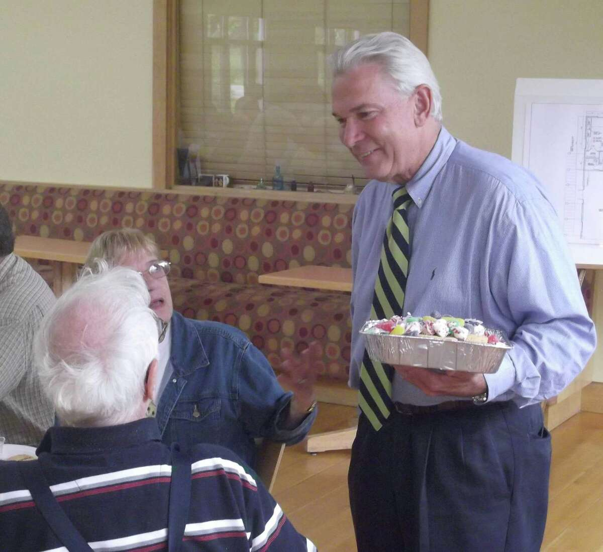 RICKY CAMPBELL/ Register Citizen Litchfield First Selectman Leo Paul, Jr. hands out desserts Thursday during the Park and Recreation Department's annual senior picnic at the Litchfield Community Center. On hand also included Park and Rec Director Brent