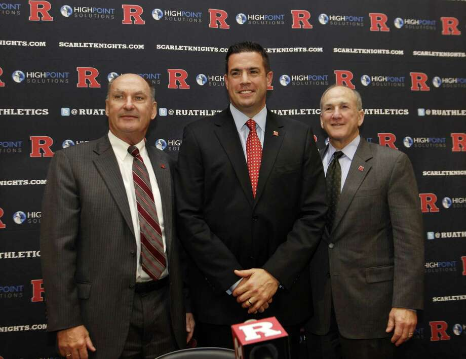 Rutgers Director of Intercollegiate Athletics Tim Pernetti, center, stands with Rutgers President Robert Barchi, right, and Big Ten Conference Commissioner Jim Delany during a news conference, Tuesday. Photo by The Associated Press Photo: ASSOCIATED PRESS / AP2012