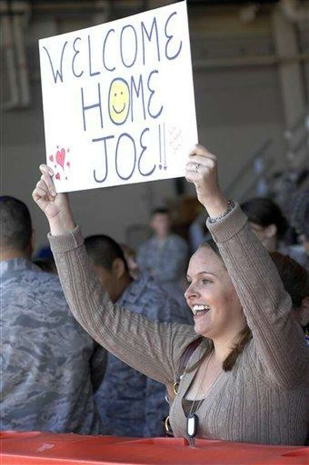 Ashleigh Lawrence celebrates the arrival of her boyfriend, Air Force Staff Sgt. Joseph Burnes, from a deployment in the Middle East earlier this month at a hangar at Hurlburt Field on Eglin Air Force Base, Fla., during Operation Homecoming. About 80 Connecticut National Guard airmen are returning home tonight.  (AP Photo/Northwest Florida Daily News, Nick Tomecek) Photo: AP / Northwest Florida Daily News