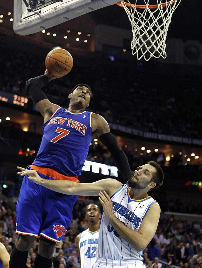 New York Knicks forward Carmelo Anthony goes up for a dunk over New Orleans Hornets forward Ryan Anderson in the first half. Photo by The Associated Press Photo: ASSOCIATED PRESS / AP2012