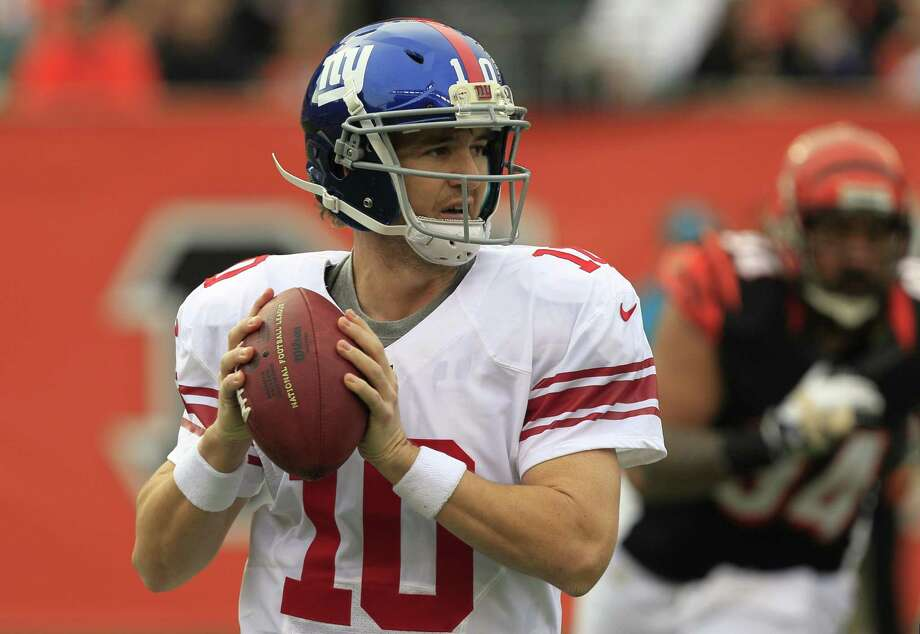 Giants quarterback Eli Manning drops back for a pass against the Cincinnati Bengals. Photo by Associated Press Photo: ASSOCIATED PRESS / AP2012
