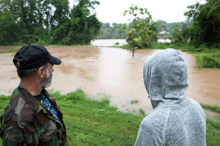 Clark Runge left, and David Garcia, stand on the banks of the Brazos River, as the water rises from heavy rains from Tropical Storm Harvey, on Monday, Aug. 28, 2017, in Richmond, Texas. ( Brett Coomer / Houston Chronicle ) Photo: Brett Coomer, Staff / © 2017 Houston Chronicle