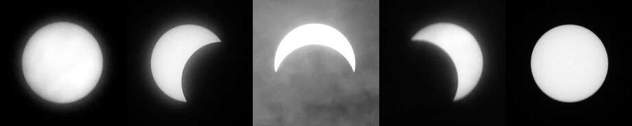 The phases of the 2017 partial solar eclipse are depicted through a series of five photographs, the middle photo during a moment of cloud cover, as seen from Greenwich on Monday. About 70 percent of the sun's surface was covered by the moon at time of peak coverage, which occurred at 2:45 p.m. in Greenwich. Photo: Tyler Sizemore / Hearst Connecticut Media / Greenwich Time