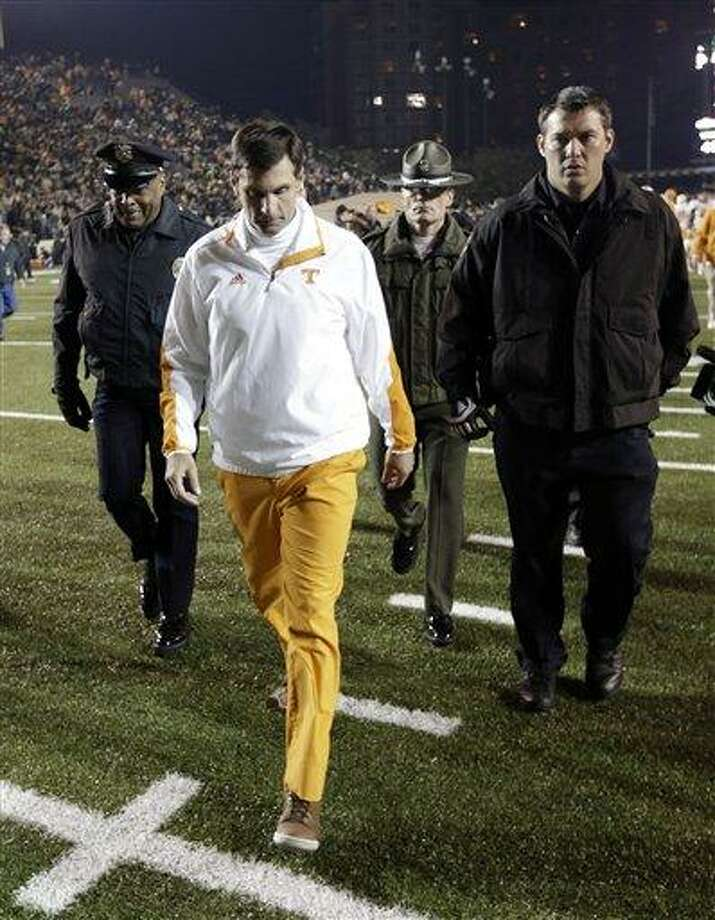 Tennessee head coach Derek Dooley, foreground, leaves the field after losing to Vanderbilt in an NCAA college football game on Saturday in Nashville, Tenn. AP Photo/Mark Humphrey Photo: AP / AP