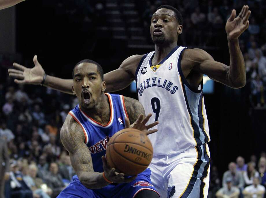 Knicks guard J.R. Smith tries to save a loose ball during Friday's game against the Memphis Grizzlies. Photo by Associated Press Photo: ASSOCIATED PRESS / AP2012