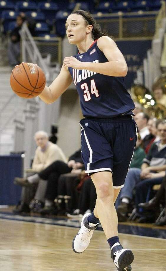 Connecticut's Kelly Faris plays in the NCAA college basketball game between Pittsburgh and Connecticut on  Tuesday, Feb. 21, 2012, in Pittsburgh. (AP Photo/\Name\) Photo: ASSOCIATED PRESS / AP2012