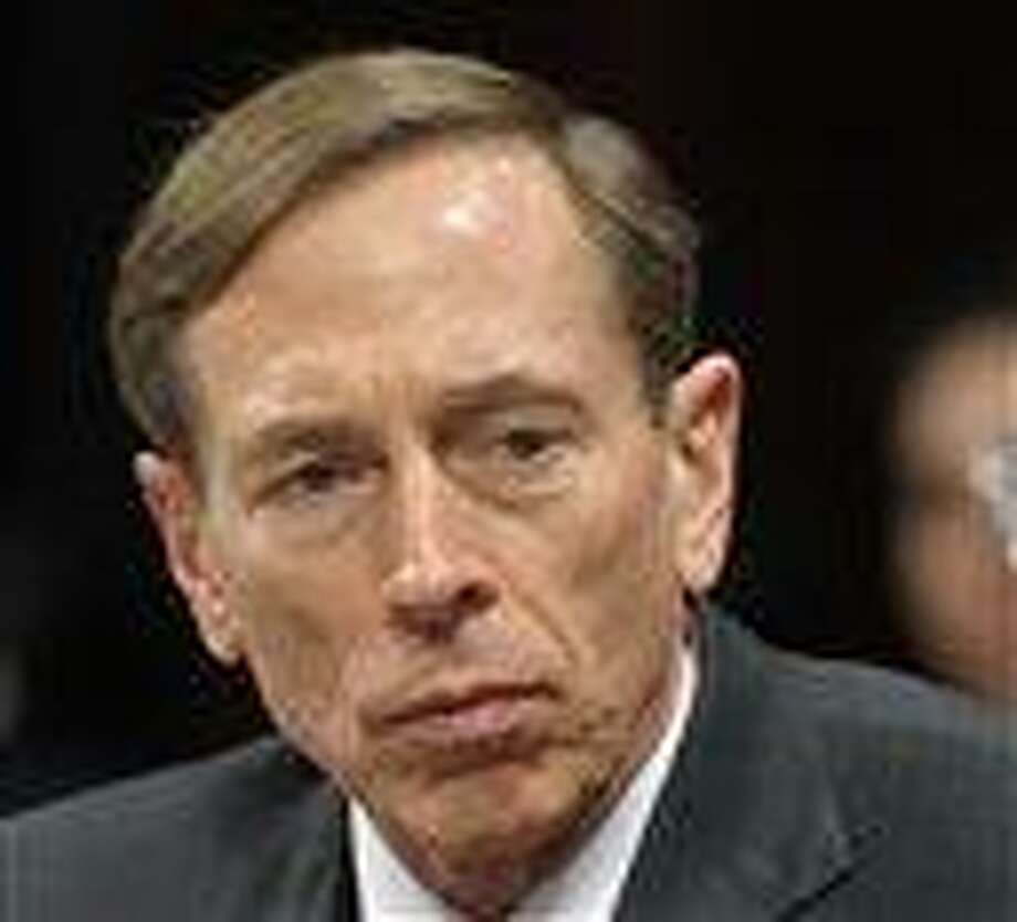 This February file photo shows CIA Director David Petraeus testifying on Capitol Hill in Washington. Petraeus testified there again Friday on the attack on the Libyan embassy. (AP Photo/Cliff Owen, File) Photo: AP / FR170079 AP