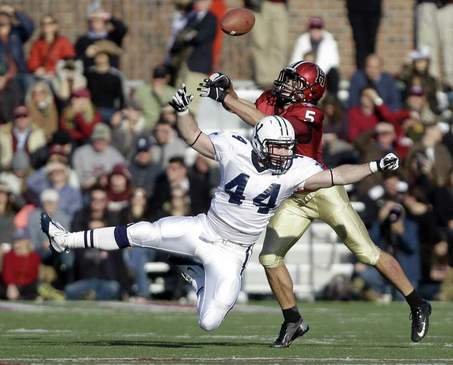 Yale linebacker Brian Leffler (44) breaks up a pass intended for Harvard wide receiver Ricky Zorn (5) during the second half of their NCAA college football game in Cambridge, Mass., Saturday, Nov. 17, 2012. (AP Photo/Mary Schwalm) Photo: ASSOCIATED PRESS / AP2012