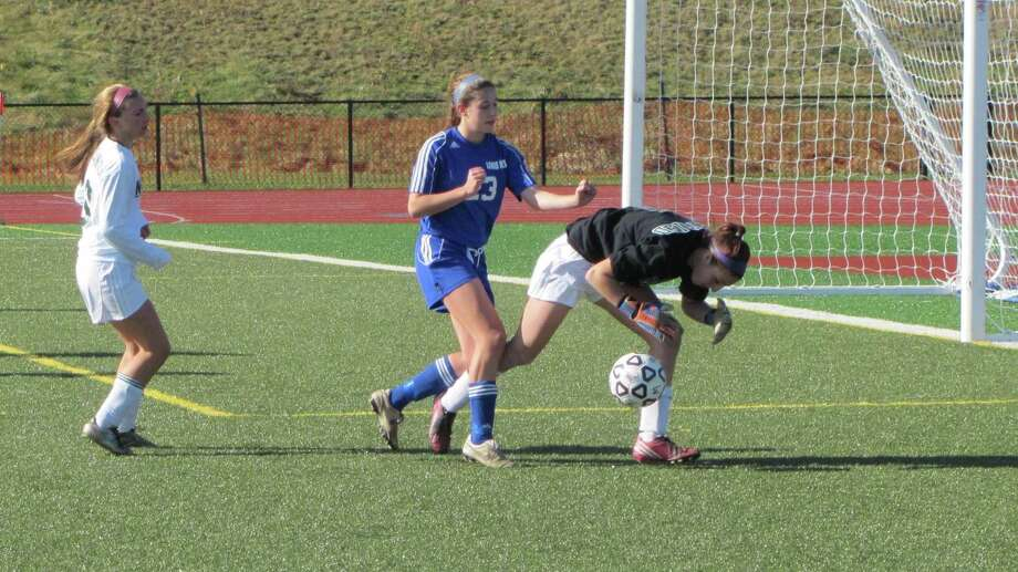 Lewis Mills' Julia Pearson battles NWC goalie Kelsey Dornfried for a loose ball in the second half of Saturday's Class M Semifinal. Photo by John Nestor/Register Citizen Correspondent
