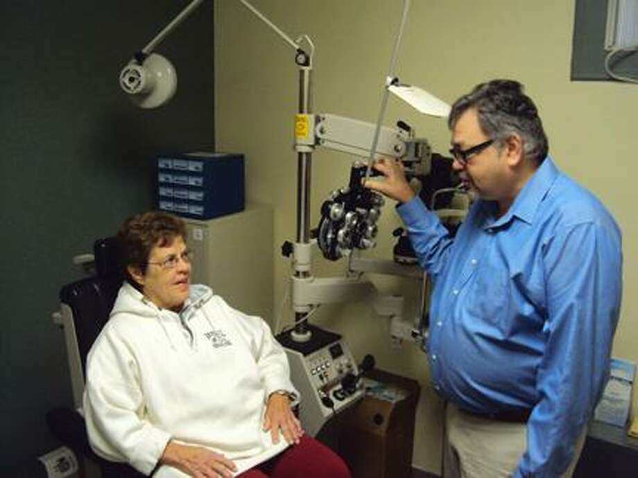 RICKY CAMPBELL/ Register Citizen Dr. Ross Zeldes bought Marshall's Optical on New Harwinton Road earlier this month and has plans to improve customer service, while maintaining current clientele.