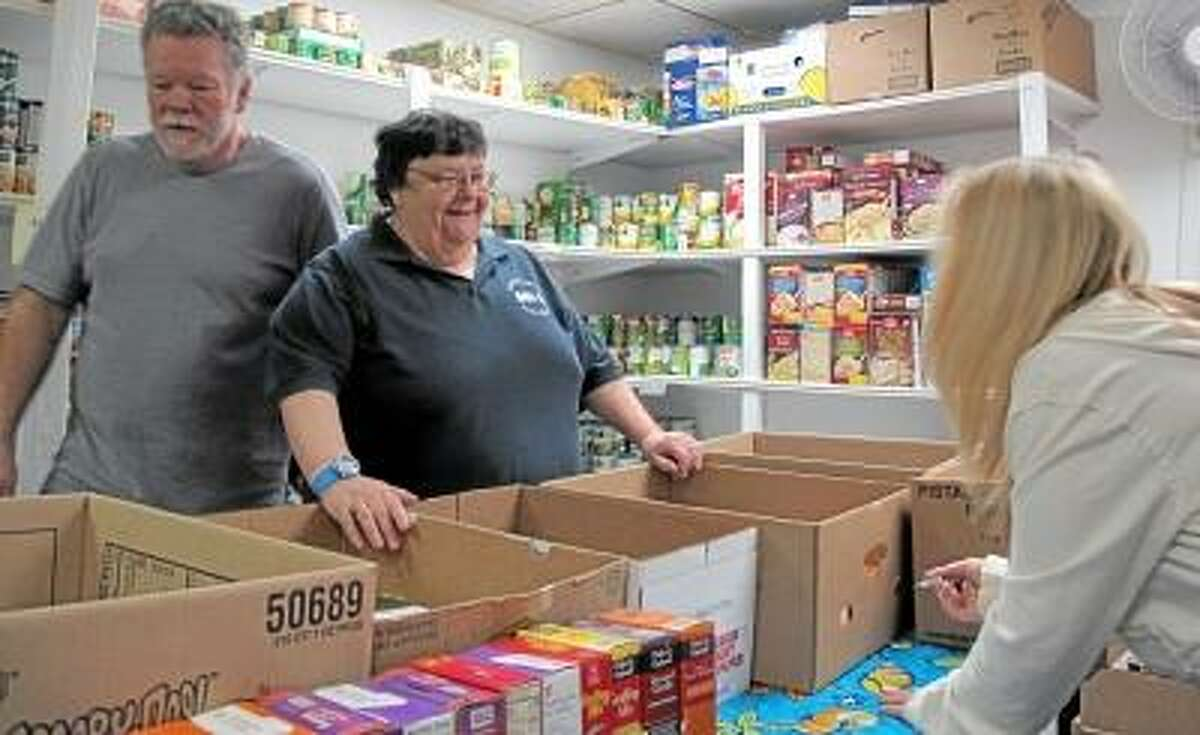 File Photo Friendly Hands Food Bank Direcctor Maureen Hubert takes stock of the food bank's resources last November in anticipation of helping hundreds of needy Torrington citizens for the holidays. This year, the food bank is in desperate need of food donations, not only for the holidays, but every day. Hubert says that people who would normally donate to the food bank are now clients.