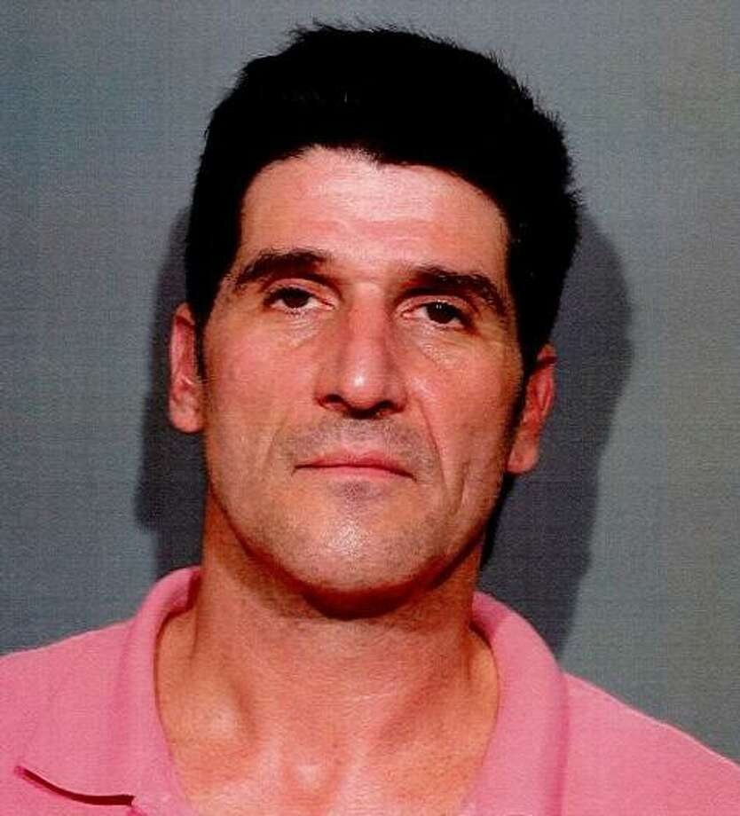 Christopher O. Johnson, 49, of Dunham Road in Hartsdale, N.Y. was charged with third-degree assault and disorderly conduct in New Canaan, Conn. on Aug. 27, 2017. Photo: Contributed Photo / Contributed Photo / New Canaan News contributed