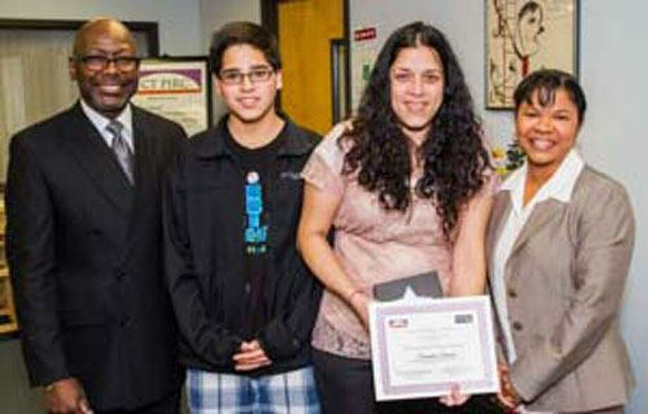 Submitted photo David R. Grice, consultant at SERC & CT PIRC, Luigi Oscasio, Claudia Oscasio, of Torrington, and Ingrid M. Canady, assistant director at SERC/CT PIRC at a ceremony on Nov. 15.