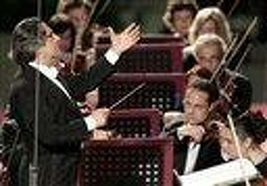 This May file photo shows Riccardo Muti conducting his orchestra during a concert  to celebrate Pope Benedict XVI's Pontificate at the Vatican. Muti, the master conductor, is sounding an ominous note, worried that the stubborn financial crisis in much of the world risks impoverishing not just public coffers but also the arts, whose budgets, often lean in good economic times, are among the biggest casualties in many countries.  (AP Photo/Gregorio Borgia, files) Photo: AP / AP