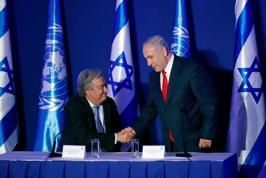 U.N. Secretary General Antonio Guterres (left) appears with Israeli Prime Minister Benjamin Netanyahu at a press conference in Jerusalem. Guterres is seeking to restart peace talks. Photo: THOMAS COEX, AFP/Getty Images