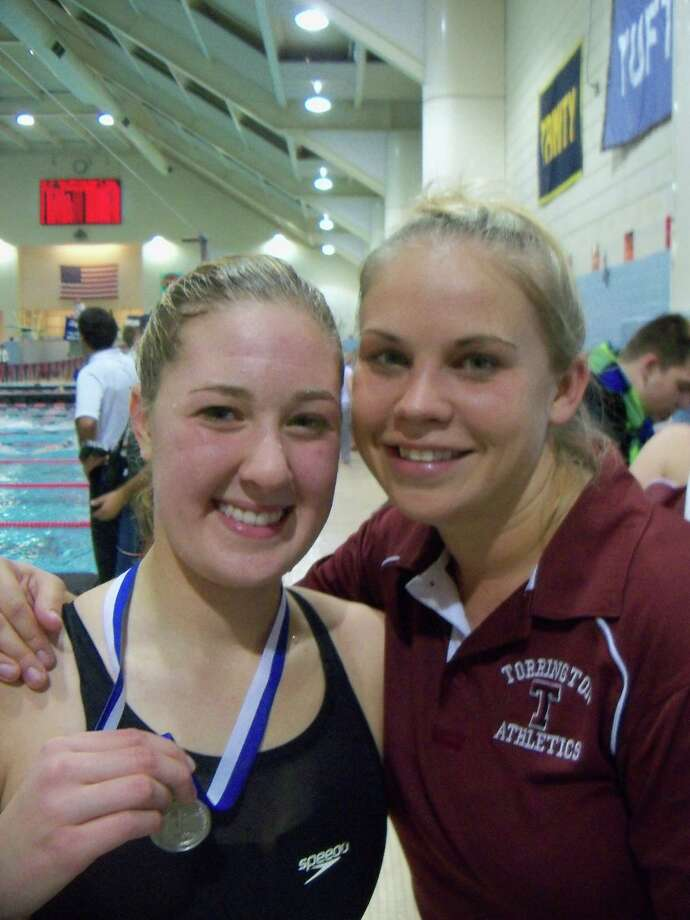 Torrington's Makenzie Welch holds her All-State medal beside Red Raider Coach Katie Block after Welch finished second in the Class M 100-yard backstroke, breaking a Torrington High School record in the process. Photo by Peter Wallace/Register Citizen
