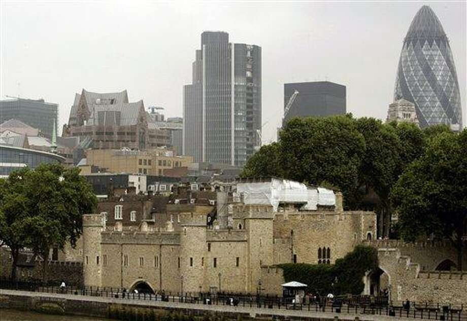 This 2007 file photo shows the Tower of London, foreground, surrounded by modern buildings in London. Associated Press Photo: AP / AP