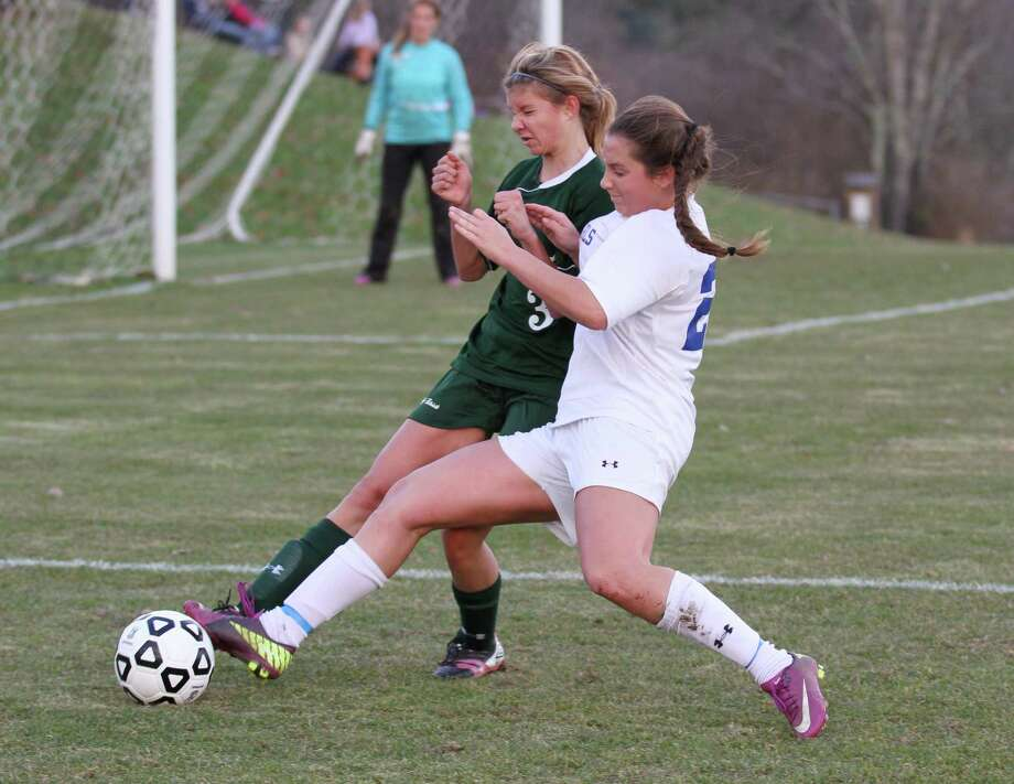 Chelsea Lamond of Litchfield fights to gain possession from Coventry's Ashley Keeney. Photo by Marianne Killackey/Special to Register Citizen