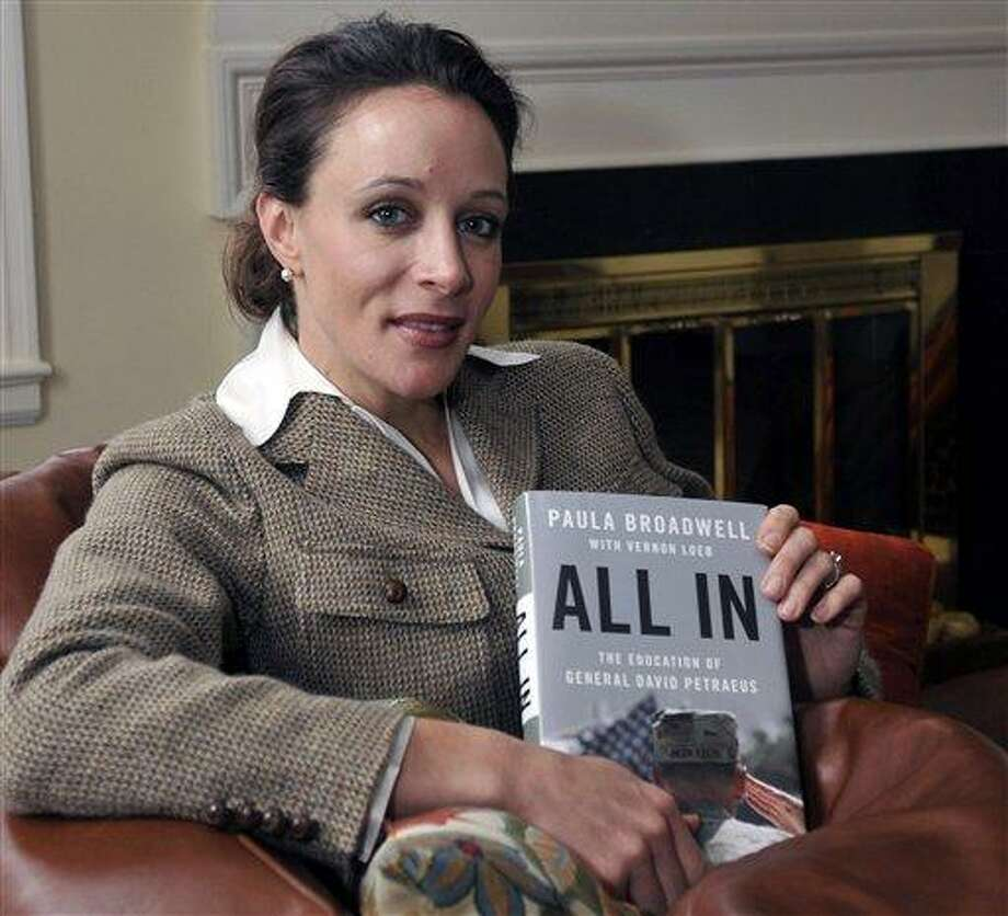 "Paula Broadwell, author of the David Petraeus biography ""All In,"" poses for photos in Charlotte, N.C. Petraeus, the retired four-star general renowned for taking charge of the military campaigns in Iraq and then Afghanistan, abruptly resigned Friday as director of the CIA, admitting to an extramarital affair. AP Photo Photo: AP / The Charlotte Observer"