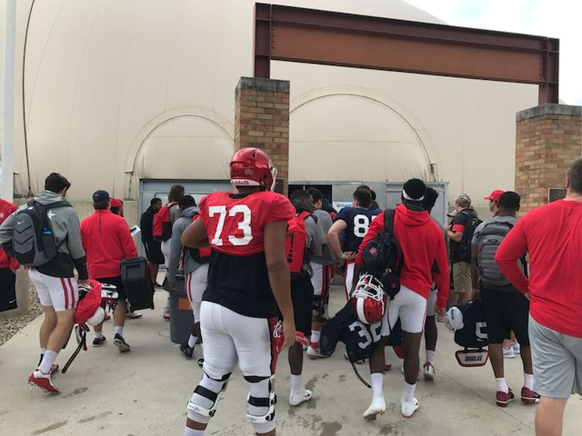 The University of Houston football team practiced Monday at the University of Texas' facilities in Austin after being displaced by Hurricane Harvey.