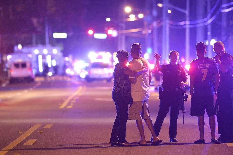 Polarized views on terrorism: The massacre at the Pulse nightclub in Orlando left 49 people dead. Photo: Phelan M. Ebenhack, Associated Press