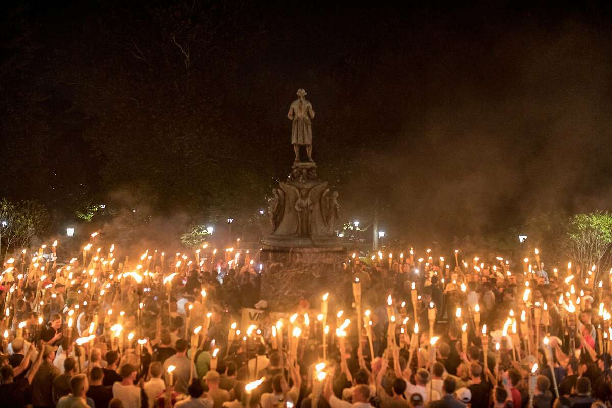 Torch-bearing white nationalists rally around a statue of Thomas Jefferson near the University of Virginia campus in Charlottesville, Aug. 11, 2017. Charlottesville hasn�t been the only place for white supremacy. TV and movies have been their own form of cluelessness. People who manufacture all sorts of popular culture have also, intentionally or not, tossed some racism onto the assembly line. (Edu Bayer/The New York Times)