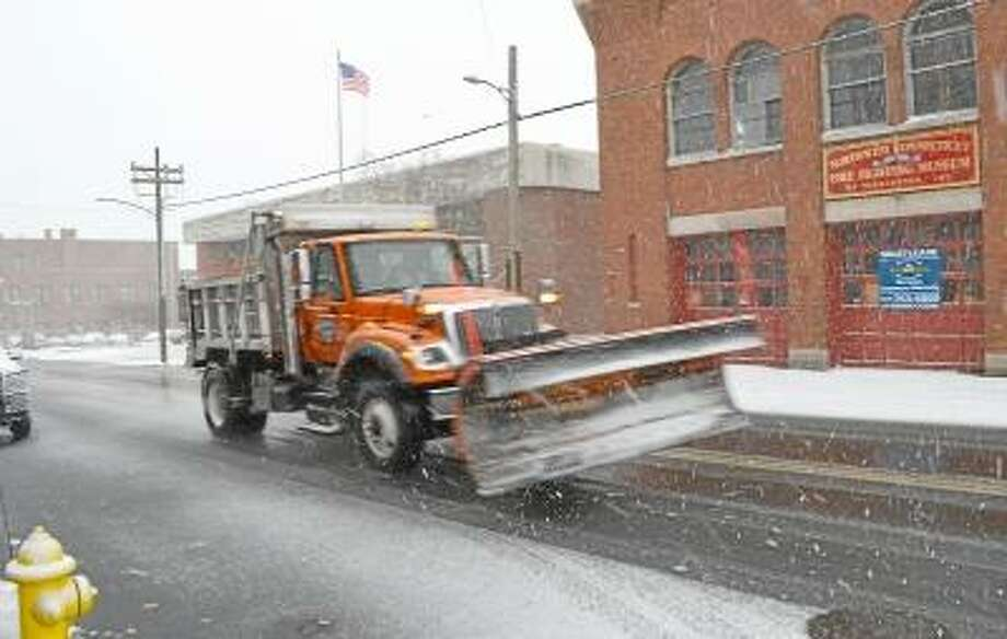 John Berry/Register Citizen  Plows were on the road early in Wednesday's storm in Torrington as the area got its first taste of winter weather this season thanks to a nor'easter that tracked through the region.