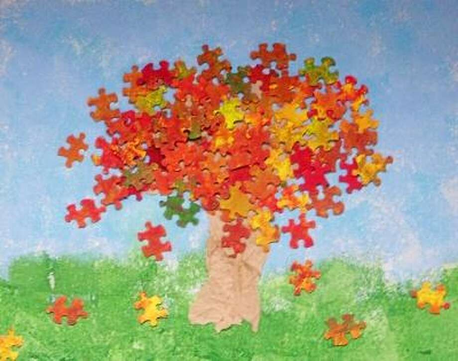 """Puzzle tree"" is the Kindergarten group project, on display at the Register Citizen Newsroom cafe for November 2012. Works of art by children from St. Anthony School in Winsted are featured."