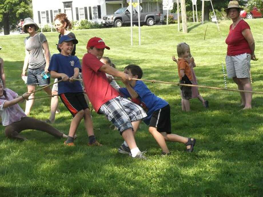 Children play tug-of-war outside the Litchfield Historical Society the same way children played it 100 years ago. (MICHELLE MERLIN / Register Citizen)