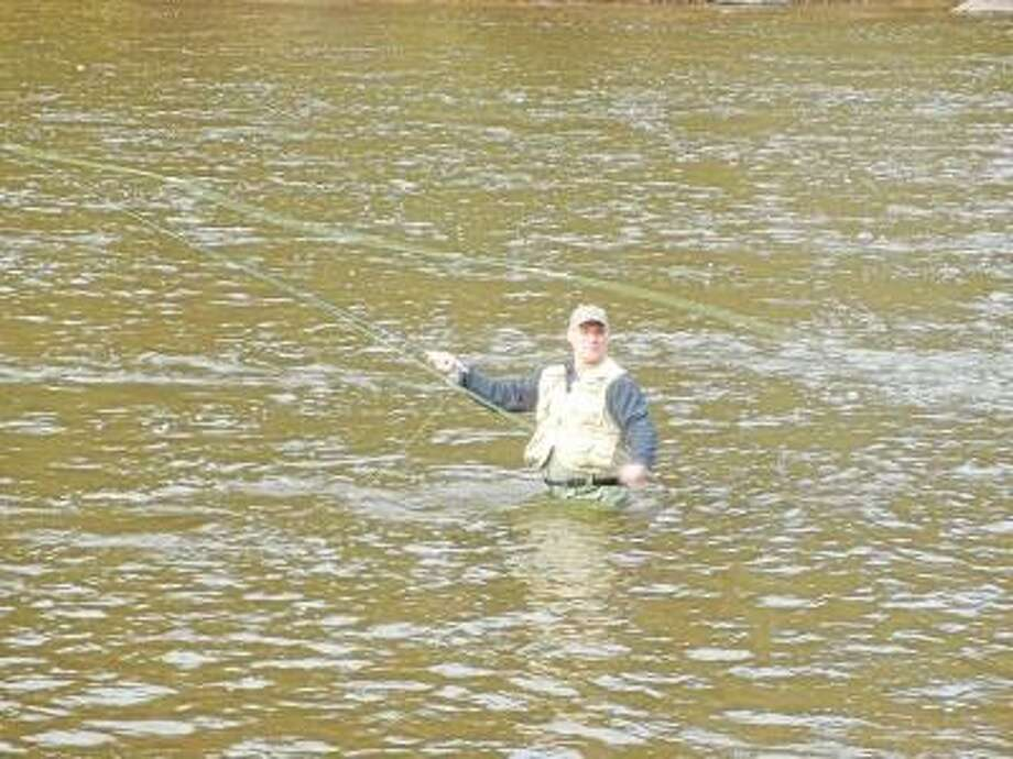 Photo by Greg Seigle Jeff Toland, 54, a general contractor from Milbrook, N.Y., tries his hand at fly fishing near the covered bridge in West Cornwall.