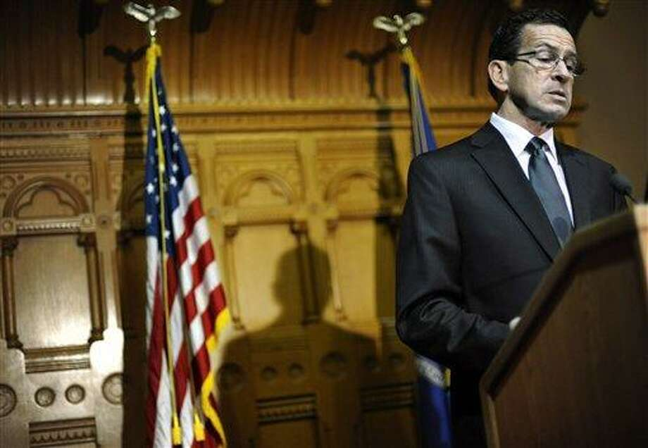 Governor Dannel P. Malloy speaks to the media at the Capitol in Hartford. (AP Photo File Photo/Jessica Hill) Photo: AP / FR125654 AP