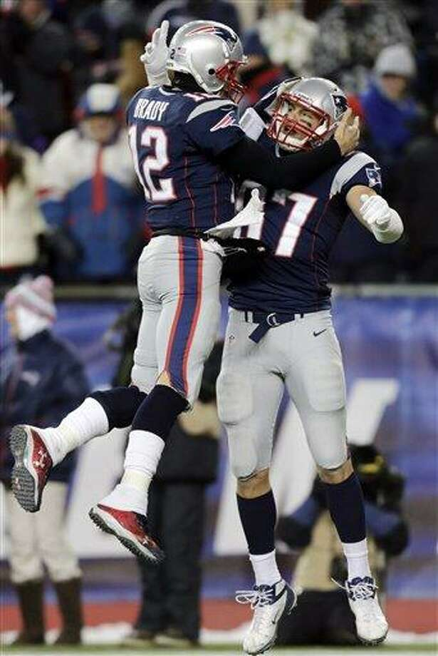 New England Patriots quarterback Tom Brady (12) celebrates his touchdown pass to tight end Rob Gronkowski (87) during the fourth quarter of an NFL football game in Foxborough, Mass., Sunday, Dec. 30, 2012. Gronkowski was active after missing five games with a broken left forearm. (AP Photo/Charles Krupa) Photo: ASSOCIATED PRESS / AP2012