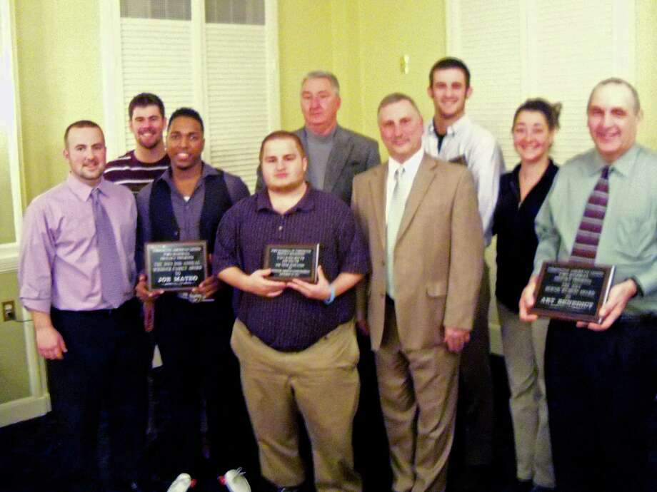 Officials and award winners at the Torrington P38 American Legion Baseball Annual Banquet were, left to right: Eric Maher, assistant coach; Andrew Gauvain, Coaches Award; Joe Mateo, Scribner Family Award; Zach McCabe, WAPJ community service award; Biff Pond, general manager; R.J. Poniatonski, head coach; Pat Austin, Player of the Year; Holly Pond, President of Operations; Art Benedict, Bernie Rubino Award. Photo by Peter Wallace/Register Citizen