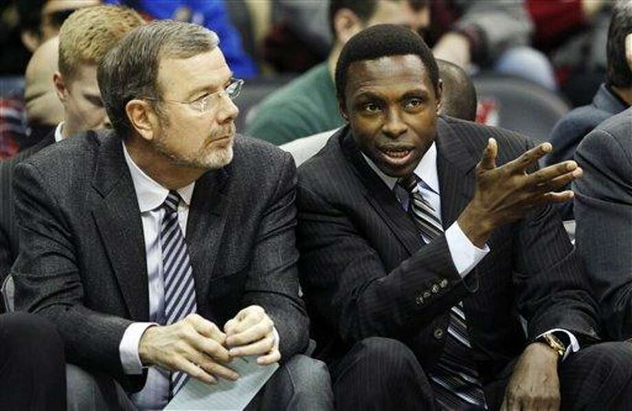 FILE- In this Dec. 17, 2011, file photo, New Jersey Nets head coach Avery Johnson, right, talks with assistant coach P.J. Carlesimo during the first half of an NBA preseason basketball game against the New York Knicks in Newark, N.J. The Nets fired Johnson on Thursday, Dec. 27, 2012, and Carlesimo will coach the team on an interim basis, starting Friday night with a home game against Charlotte. (AP Photo/Mel Evans, File) Photo: ASSOCIATED PRESS / A2011