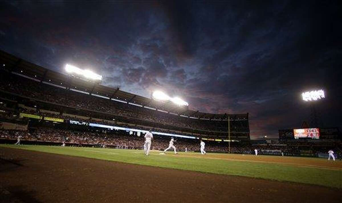 Boston Red Sox's Jarrod Saltalamacchia, center left, rounds first base after a home run against the Los Angeles Angels during the second inning of an baseball in Anaheim, Calif. Tuesday, Aug. 28, 2012. (AP Photo/Chris Carlson)