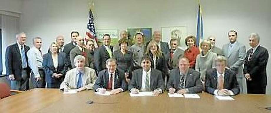 Submitted photo Above, representatives from the waste management company Covanta Bristol and the municipalities that make up the Bristol Resource Recovery. Burlington just signed a 20-year contract with the company.