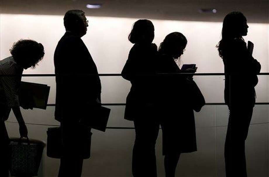 """Job seekers join a line of hundreds of people at a job fair sponsored by <a href=""""http://Monster.com"""">Monster.com</a> in New York in 2009.(AP File Photo/Mark Lennihan) Photo: AP / AP"""