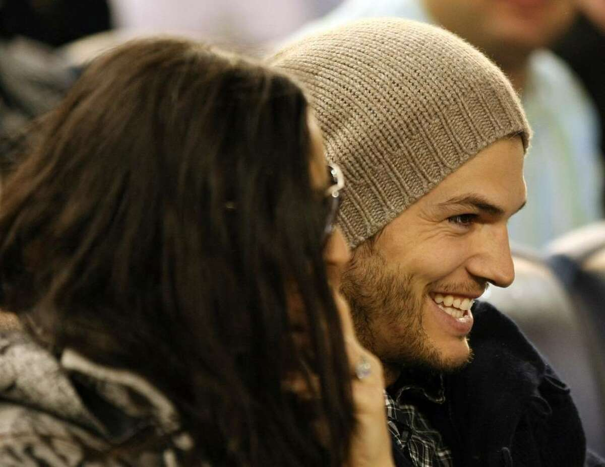 NEW YORK - APRIL 15: Demi Moore (L) and Ashton Kutcher watch the New York Yankees game against the Los Angeles Angels of Anaheim on April 15, 2010 at Yankee Stadium in the Bronx borough of New York City. (Photo by Al Bello/Getty Images) *** Local Caption *** Demi Moore;Ashton Kutcher