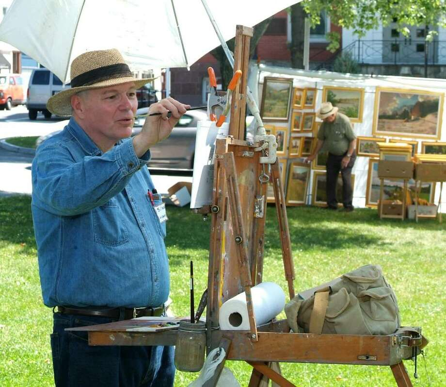 Bill Merklein, of Gaylordsville, paints a landscape during the New Milford Outdoor Art Festival, on the New Milford Town Green, on Saturday, June 19, 2010. Photo: Jay Weir / The News-Times Freelance