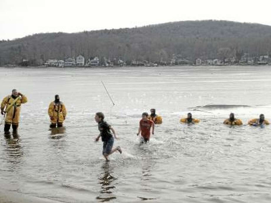 File photo Hardy residents of Litchfield County, like these brave souls from 2011's Penguin Plunge, will once again leap into the freezing waters of Highland Lake on Feb. 9 to benefit Special Olympics.