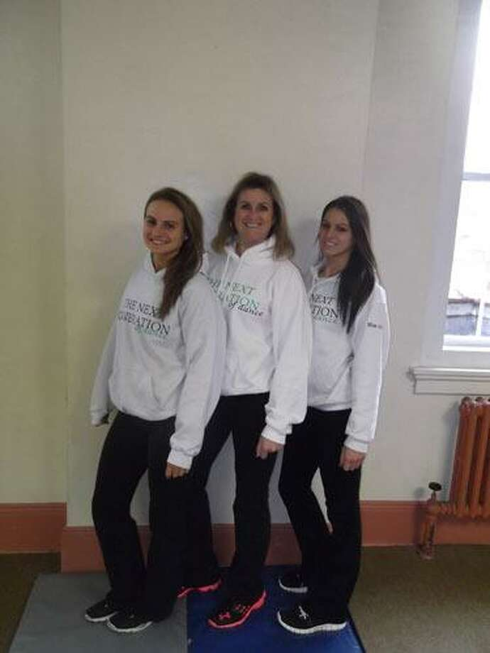 Submitted Photo Sherry Grech (middle) stands with her daughters Jenna Laigle, 23, and Aly Laigle, 22. The mother-daughter team teaches dance classes in several surrounding towns and support and work off each other through their love of dance.
