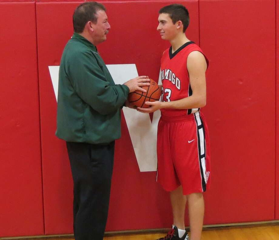 O'Brien Tech head coach Daniel Nemergut stands with his son and Wamogo senior guard Nick Nemergut. Submitted Photo